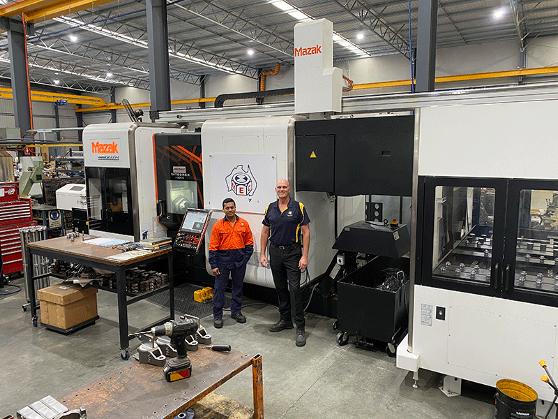 Andrew Melvelle right in front of his Mazak Integrex i 200S and a Mazak GL 150F gantry loader